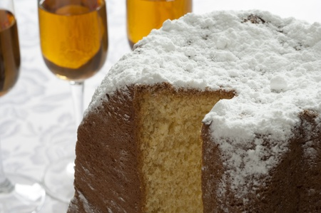 Close-up view of Pandoro, Italian traditional christmas cake from Verona, and Wine glasses
