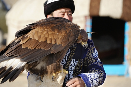 Kosh-Agach,Russia - September 21, 2014: the hunter with an eagle at the festival: Berkut-wing Chu steppe
