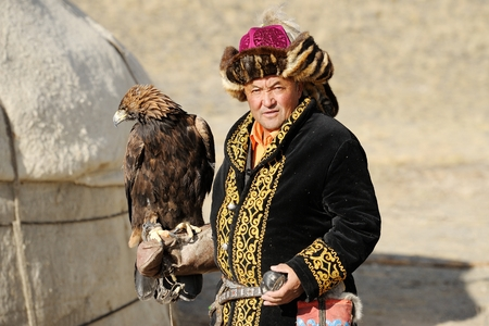 mongol: Kosh-Agach,Russia - September 21, 2014: the hunter with an eagle at the festival: Berkut-wing Chu steppe