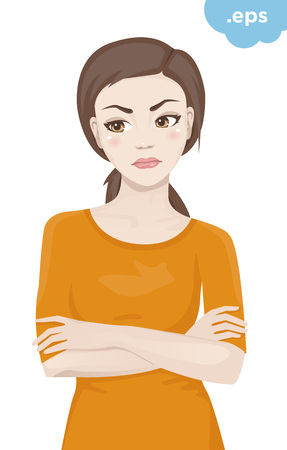 Offended young woman crossed her arms. A girl standing in an orange sweater with her arms crossed over his chest.