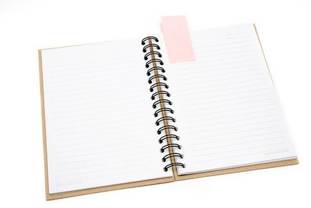 Recycled paper notebook cover open with pink reminder in isolated photo
