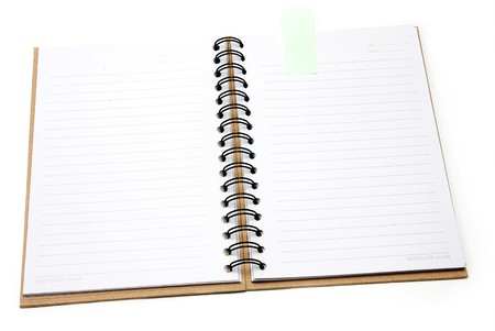 Recycled paper notebook cover open with green reminder in isolated photo