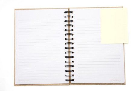 Recycled paper notebook cover open with yellow reminder in isolated photo