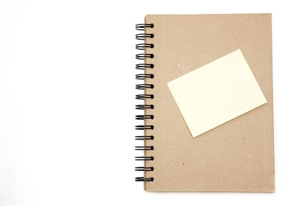 Recycled paper notebook hard cover with yellow reminder in isolated photo