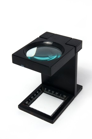 reproductive technology: Loupe magnification and film printing industry on isolated Stock Photo