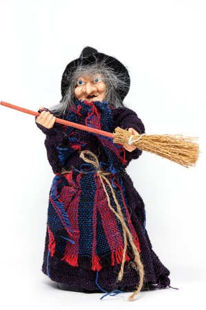 Old Halloween witch with broomstick and hat isolated on white background photo