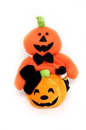 Trick halloween ghost caddy and smiling pumpkin shaped doll photo