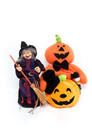 Witch trick halloween ghost caddy and smiling pumpkin shaped doll photo