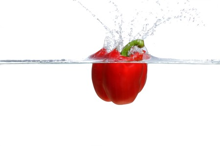 Fresh Red Bell Pepper splashing into water