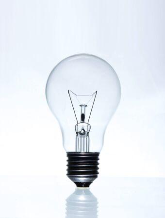Eletric light lamp on gray gradient background Imagens