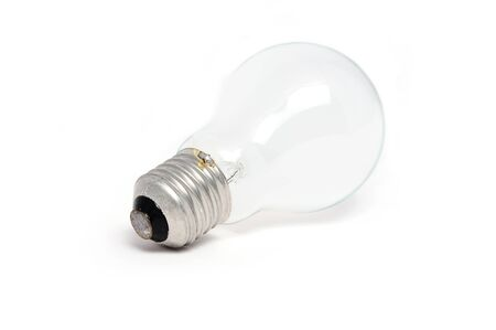 Light bulb on a white surface Stock Photo