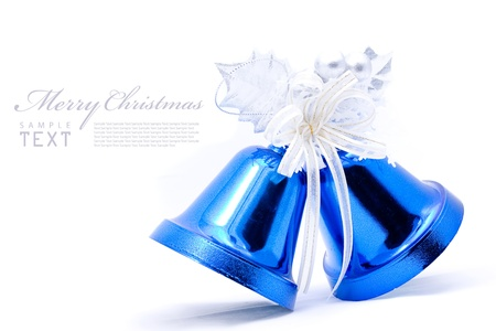 Blue christmas bell and silver bow ribon on white background with copy space