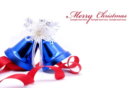 Blue christmas bell and red bow ribon on white background with copy space photo