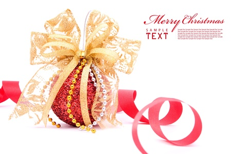 shimmery: Red christmas balls and gold bow ribbon on white background with copy space