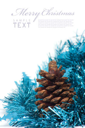 Christmas cones and blue glitter on a white background with copy space