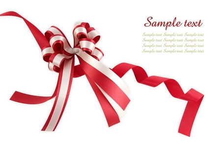 anniversary sale: Shiny red ribbon bow on white background with copy space