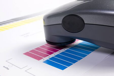 Colour Management - Spectrophotometer and calibration chart Stock Photo
