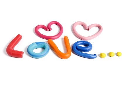 Love written with plasticine isolated on white background Stock Photo