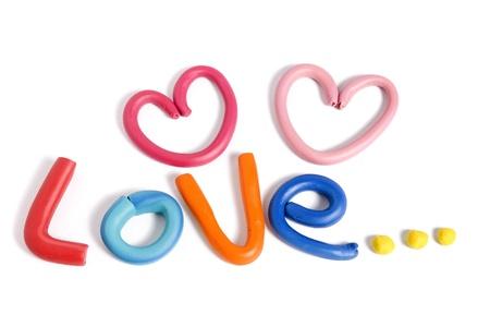 Lettre d'amour écrite avec de la plasticine isolé sur fond blanc Banque d'images