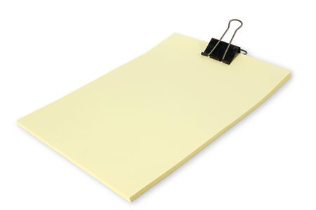 Black clip and Yellow blank note paper photo