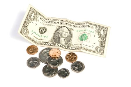 Pile of paper money and change on isolated white