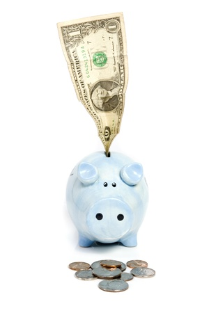 Blue piggy bank savings banknote and coins on white isolated photo