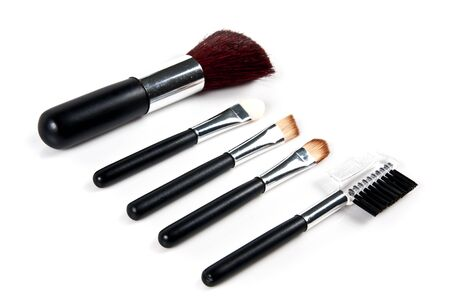 Cosmetic Brushes on white background photo
