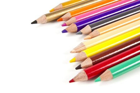 descriptive colour: Color pencils in arrange in color wheel colors on white background