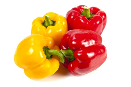 Yellow and red bell pepper on white background