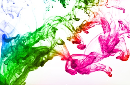 Multicolor ink isolated dissolving in water photo