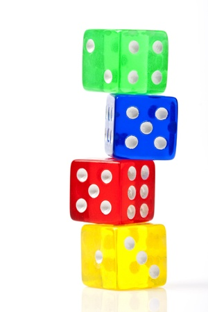 Colorful stack dices on the white background photo
