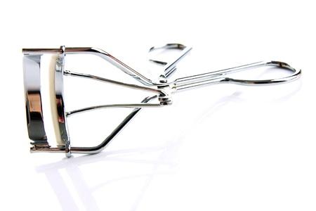 curler: Eyelash curler on the white background Stock Photo