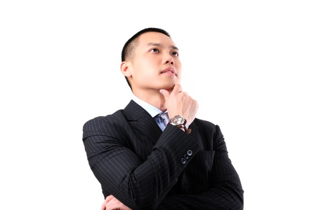 Closeup of a handsome young asian business man thinking on white background