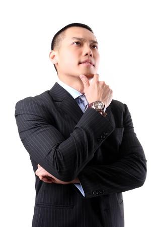 흰색 배경에 생각하는 잘 생긴 젊은 아시아 비즈니스 남자의 근접 촬영 스톡 사진