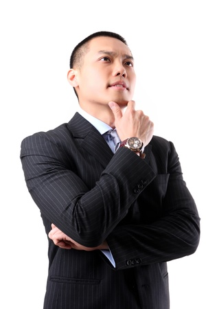 Closeup of a handsome young asian business man thinking on white background photo