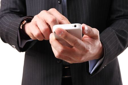 Asian businessman using a mobile phone on the white background photo