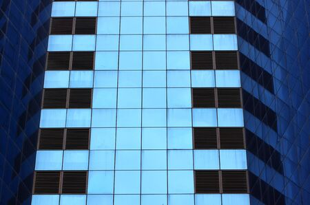 highrise glass building with reflection photo