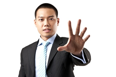 Asian business man with hand stop sign on white background