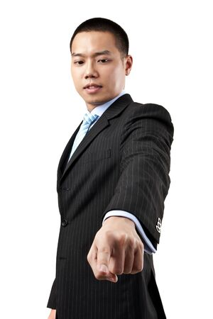 Business man pressing an imaginary button over white background photo