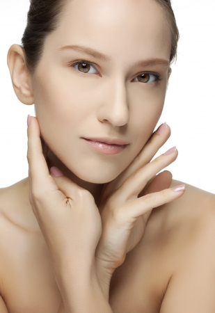 Beautiful Young Woman touching her Face  Skincare  Perfect Skin  Spa isolated on a white background Stock Photo - 18300110