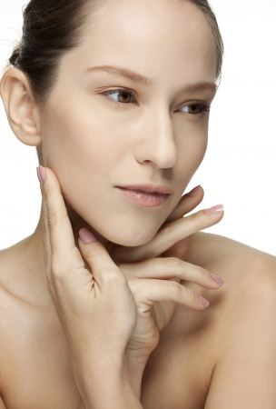 Beautiful Young Woman touching her Face  Skincare  Perfect Skin  Spa isolated on a white background Stock Photo - 18300111
