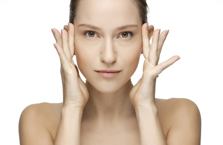Beautiful Young Woman touching her Face  Skincare  Perfect Skin  Spa isolated on a white background Stock Photo - 18300108