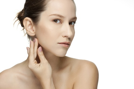 Beautiful Young Woman touching her Face  Skincare  Perfect Skin  Spa isolated on a white background Stock Photo - 18300113