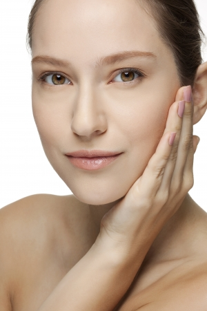 Beautiful Young Woman touching her Face  Skincare  Perfect Skin  Spa isolated on a white background Stock Photo - 18300114