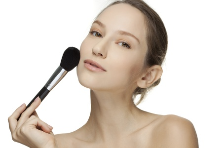 Portrait of attractive young adult woman applying blusher Stock Photo - 18299539