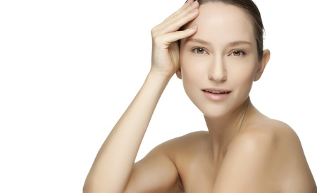 Beautiful young woman with clean skin of the face. Pretty female posing on white background Stock Photo