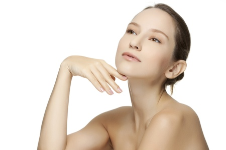Beautiful young woman with clean skin of the face. Pretty female posing on white background Stock Photo - 18708815