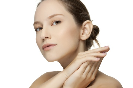 Beautiful young woman with clean skin of the face. Pretty female posing on white backgroun