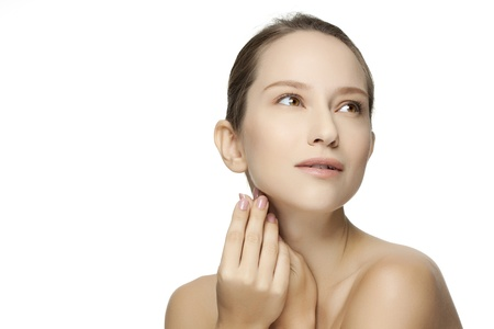 Beautiful Young Woman touching her Face. Skincare .Perfect Skin. Spa isolated on a white background Stock Photo
