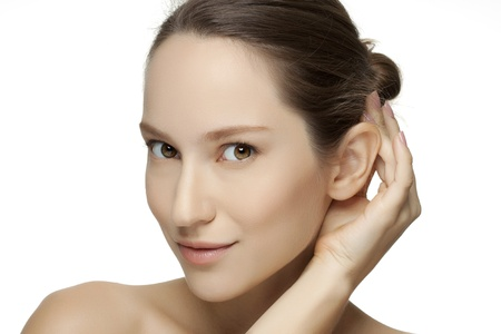 Beautiful young woman with clean skin of the face. Pretty female posing on white background 스톡 사진